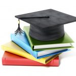 Isolated mortarboard standing on book stack