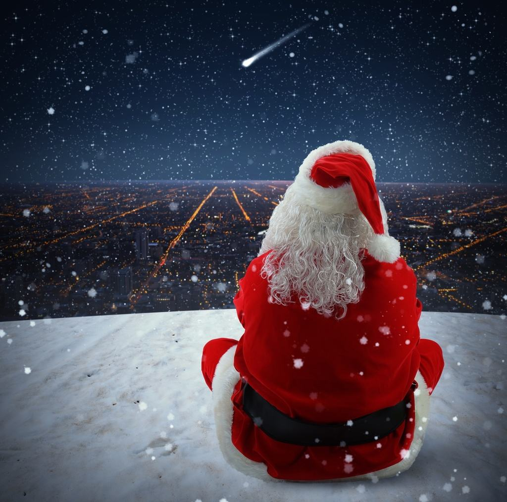 Santa Claus watches a sparkling falling star
